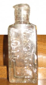 Rowland Macassar Oil bottle.